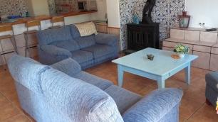 Bienvenidos @ El CaprichoWoonkamer van Casa Azul